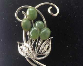 1950s jade and silvertone flower brooch