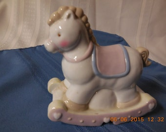 Ceramic baby rocking horse decoration to sit on a shelf in the nursery or a small childs room.