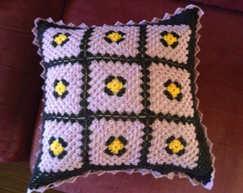 Decorative Pillow with yellow flowers.