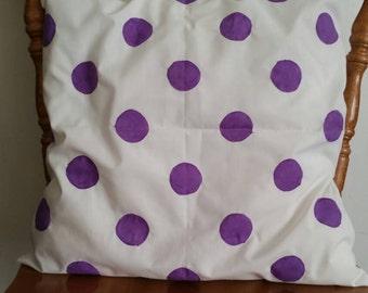Purple polkadot cushion cover.