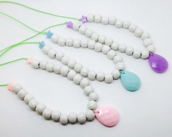 Wooden bead necklace with pastel pendant