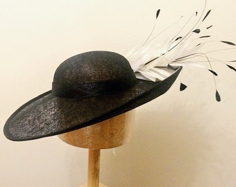 Upturn Black Sinamay Hat, Ascot Hat, Dubai Gold Cup, Melbourne Cup, Kentucky Derby, Weddings, Races, Polo Cup, Royal Regatta.