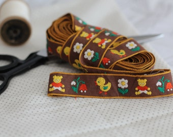 Vintage brown woven jacquard ribbon trim with embroidered children motif
