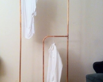 Built to spec, copper clothes rail with scaffold plank base.