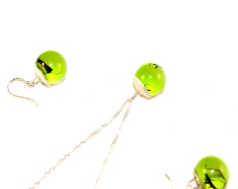 green jewellery set with botanical form