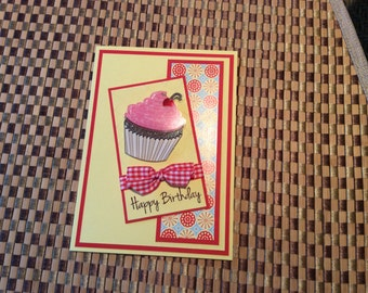 Handmade Greeting Card:  Happy Birthday card with 3 D cupcake. Pink frosting with cherry.
