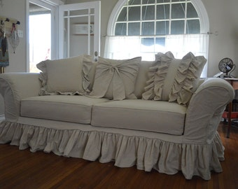 Drop cloth slipcover. Custom slipcover tailor made to fit your sofa perfectly. Shabby, ruffles and bows slipcover.