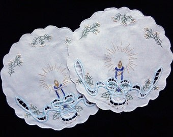 Set of two embroidered doilies
