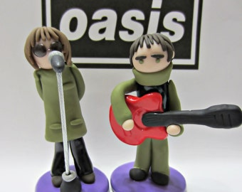 Oasis Band Figure. Liam Gallagher. Noel Gallagher. Be here now. Brit pop