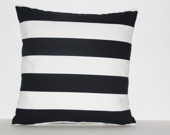 Striped cushion with Feather insert.