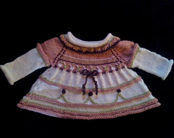 Beautiful Hand Knitted Baby Dress in Pink and Green