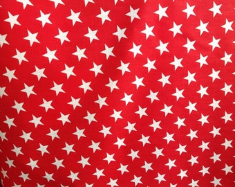 Poly cotton stars fabric red. Sold by the yard.