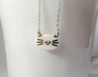 tiny porcelain kitty cat silver necklace