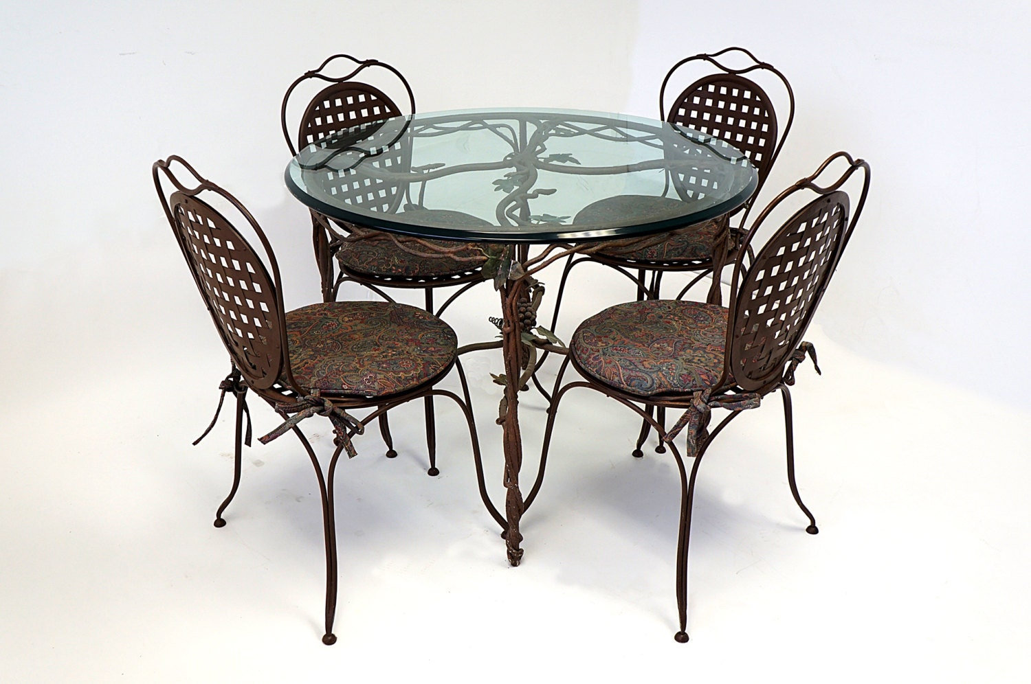 Wrought iron glass top table four chairs cushioned painted for Wrought iron and glass table
