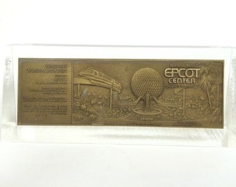 Bronze Commemorative Park Admission Ticket from EPCOT Center October 1,1982 Paperweight encased in Lucite Walt Disney World