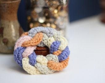circular crocheted brooch