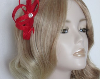 RED FASCINATOR, Made of Sinamay, with biot,coque feathers, Crystal and pearl detail, on a comb