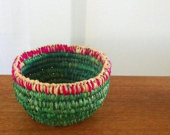 Small, handmade, raffia and yarn coiled basket