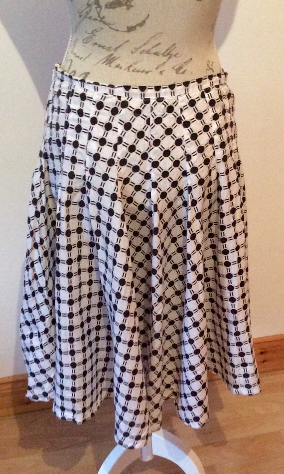 white and black spotty cotton knee length skirt