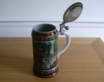 Lidded Stein With Ornate Decoration and Hunting Scene.