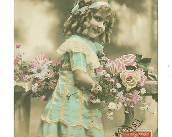 French antique postcard. Little girl with flowers 1912.