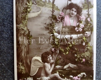 another Cherub, a Lady, and a Well // Antique surreal postcard, Edwardian curiosity RPPC fantasy postcard cherub draws woman from well