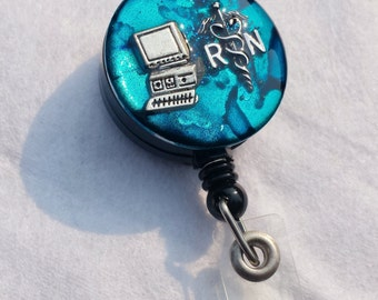Informatics nurse name badge holder with a teal background, RN caduceus and computer detail