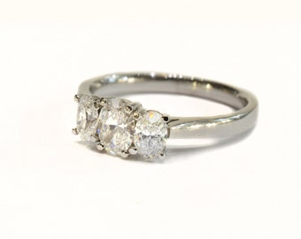 Oval Cut Three-Stone Diamond Ring set in Platinum