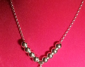 Sterling Silver Pendant with 8 Sterling Silver 8mm Round Beads