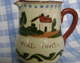 Mottoware jug,'Still waters run deep' souvenir from Kents Cavern,by Royal Watcombe Pottery Torquay.Traditional cottage decoration, brown rim