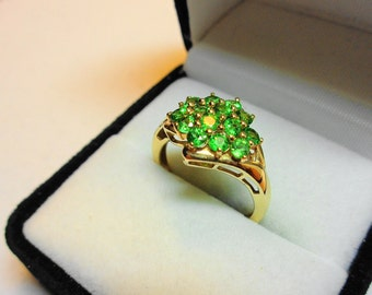 Tsavorite Garnet Ring. Set in a 14kt. Gold Cluster Ring. Never Worn.