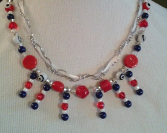 4th of July necklace, textured, multistrand. Red white and blue beads with silver tone chain and white ribbon.