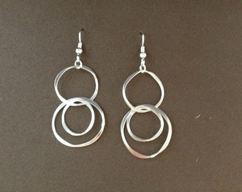 Three circle argentium silver dangle earrings.