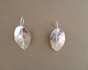 Silver fat leaf dangle earring.