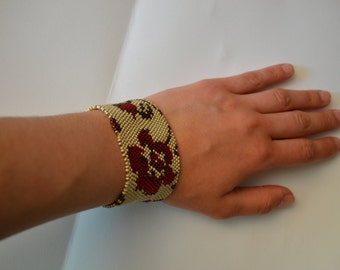 Red flower peyote beaded bracelet.
