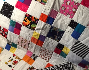 """Multicolored """"I spy"""" type baby quilt.  Great for tummy time!"""