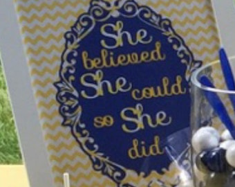 """Framed quote """"She believed she could..."""""""