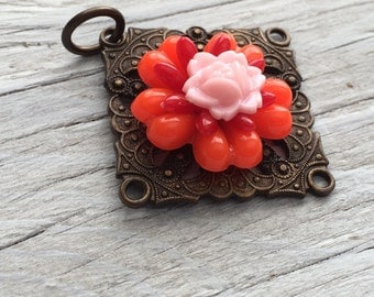 Antiqued brass pendant with pink red and orange flowers 45mm