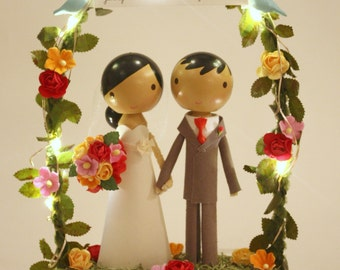 twinkle lights wedding cake topper with white base & floral arch