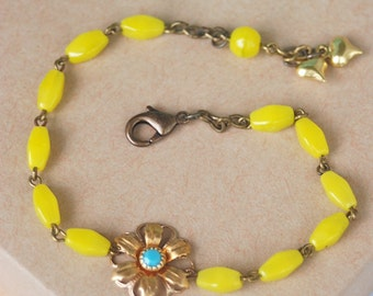 Bohemian yellow glass beaded flower and heart charm bracelet. boho jewelry Tiedupmemories