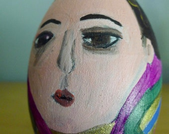 Erté as an egg. Painted wooden egg by Vivienne Strauss.
