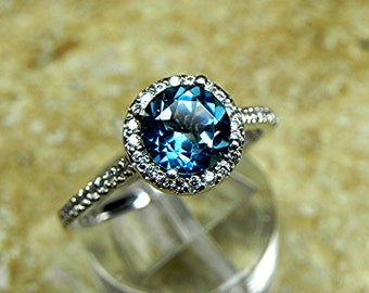AAAA London Blue Topaz Round Natural   7.00mm  1.50 Carats   14K white gold Halo ring with .30 carats of diamonds MMM