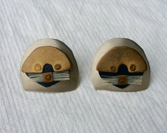 Vintage handmade otter earrings // Brutalist // Brass
