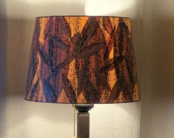 Eucalypt table lamp with sheet music collage shade