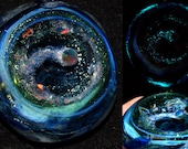 Exquisite Encased Opal Planet Breaking up into Chunks and Dust Spiraling into a Black Hole with Glowing Stars Pendant - Handblown Glass