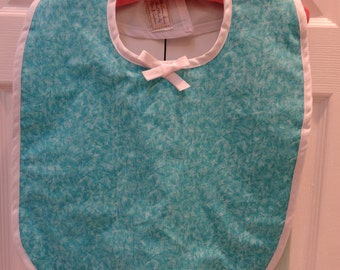 SPECIAL NEEDS, Adult Bib, make-up ,special needs , turquoise /teal cotton wit white bias trim,reversible white vinyl flannel backed lining