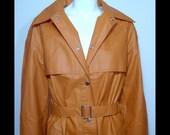 1970s Rukka orange raincoat ~ Small / Medium ~ pvc vinyl rubber ~ spy girl trenchcoat with snaps and belt ~ tan pumpkin ~ deadstock 70s