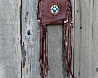 Beaded wolf paw fringed leather bag