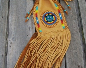 Fringed drawstring shoulder bag with a turtle totem and rainbow beadwork