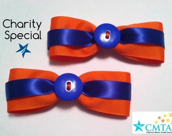 CMTA pair of orange and blue hair bows. 50% of sale goes to charity.